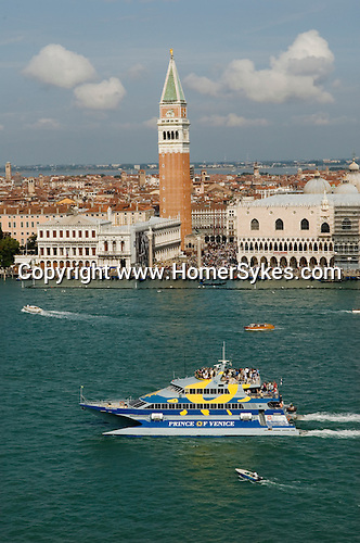 Venice Italy 2009. Tourists cruise ship sails down the Canale della Giudecca. The Bell Tower St Marks Square Piazza San Marco.