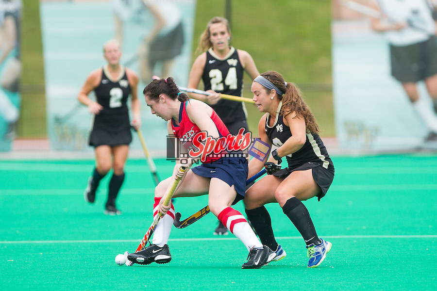 Amy Cooke (11) of the Richmond Spiders tries to keep the ball away from Kari Walkley (6) of the Wake Forest Demon Deacons at Kentner Stadium on September 29, 2013 in Winston-Salem, North Carolina.  The Demon Deacons defeated the Spiders 1-0 in overtime.  (Brian Westerholt/Sports On Film)