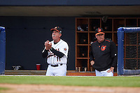 Frederick Keys manager Keith Bodie (11) and Orioles Director of Player Development Brian Graham in the dugout during a game against the Carolina Mudcats on June 4, 2016 at Nymeo Field at Harry Grove Stadium in Frederick, Maryland.  Frederick defeated Carolina 5-4 in eleven innings.  (Mike Janes/Four Seam Images)