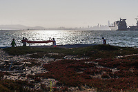 Preparing to launch outrigger canoes into the Seaplane Lagoon at Encinal Beach in Alameda, California.