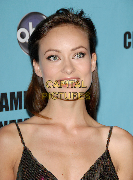 OLIVIA WILDE  .at the 24th annual American Cinematheque Award presentation to Matt Damon held at The Beverly Hilton Hotel in Beverly Hills, California, USA, March 27th 2010                                                                    .portrait headshot smiling make-up straps  gold bronze sequined sequin .CAP/RKE/DVS.©DVS/RockinExposures/Capital Pictures