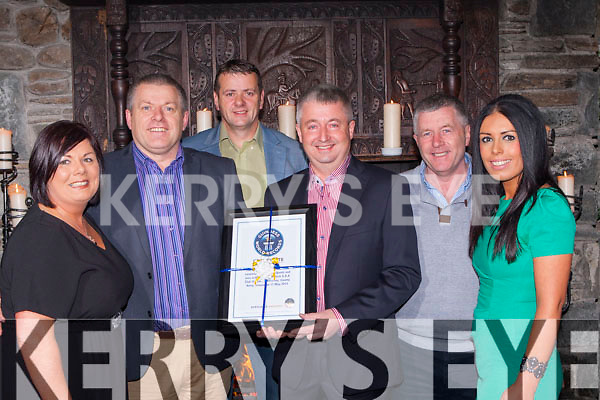 The committee behind the World Record breaking Glenflesk Wellies presents the official Guinness World Record certificate to Glenflesk GAA Chairman John Kelliher in the Muckross Park Hotel on Friday night l-r: Cathy Somers, Paud O'Donoghue, Derry Healy, John Kelliher, John O'Donoghue and Danielle Favier