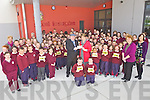 PRESENTATION: Niall Butler from Ballybunion presenting 1,000 to principal, Eily Walsh and the pupils of Scoil Iosagain in Ballybunion for the autism unit at the school, on behalf of the Irish Coursing Club.