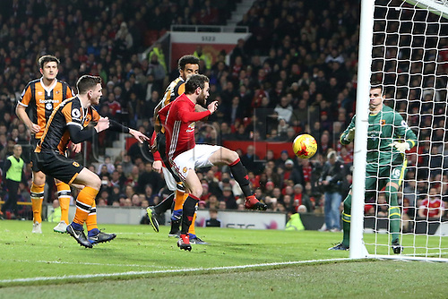 10.01.2017.  Old Trafford, Manchester, Lancashire, England. EFL Cup semi-final 1st leg, Manchester United versus Hull FC. Juan Mata of Manchester United beats Eldin Jakupovic of Hull City with a volley from close range to give his team a 1-0 lead.