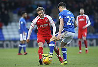 Fleetwood Town's Wes Burns (left) puts pressure on Oldham Athletic's Rob Hunt (right) during the Sky Bet League 1 match between Oldham Athletic and Fleetwood Town at Boundary Park, Oldham, England on 26 December 2017. Photo by Juel Miah / PRiME Media Images.