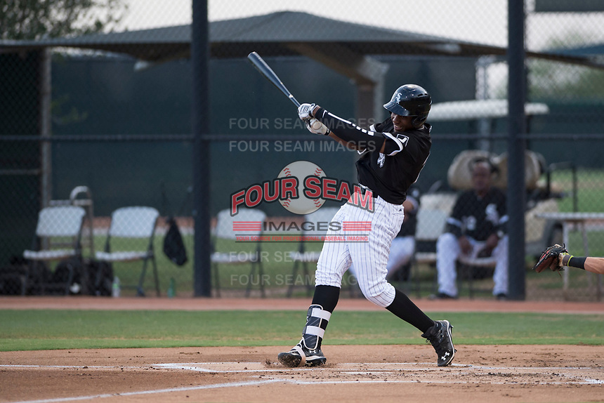 AZL White Sox center fielder Luis Mieses (22) follows through on his swing during an Arizona League game against the AZL Mariners at Camelback Ranch on July 8, 2018 in Glendale, Arizona. The AZL White Sox defeated the AZL Mariners 8-5. (Zachary Lucy/Four Seam Images)