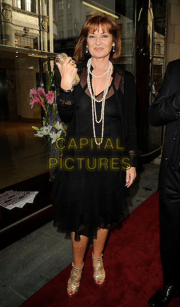 "STEPHANIE BEACHAM.The ""Dreamboats & Petticoats the Musical"" press night, Savoy Theatre, The Strand, London, England..July 27th, 2009.full length black sheer dress gold sandals shoes clutch bag pearl necklace .CAP/CAN.©Can Nguyen/Capital Pictures."