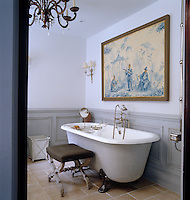 The color palette in this bathroom was drawn from the Italian chinoiserie-style painting over the Barber Wilsons footed tub