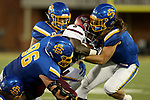 BROOKINGS, SD - OCTOBER 7: Spencer Hildahl #96 and Christian Rozeboom #2 from South Dakota State University bring down Daquan Isom #5 from Southern Illinois in the first half of their game Saturday night at Dana J. Dykhouse Stadium in Brookings. (Photo by Dave Eggen/Inertia)