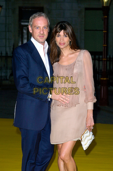 ANTON BILTON & LISA BARBUSCIA.Royal Academy Summer Exhibition 2007 arrivals, at the Royal Academy of Arts, Piccadilly, London, England..June 6th, 2007 .half 3/4 length b beige sheer dress sleeves white bag purse blue suit hand on stomach married husband wife .CAP/CAN.©Can Nguyen/Capital Pictures
