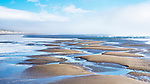 Patterns in sand, low tide, Nehalem Bay, Nehalem Bay State Park, Oregon.  Between the Pacific Ocean and Nehalem Bay, looking north to Manzanita, Oregon