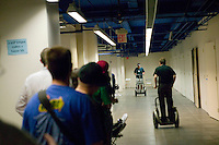 Attendees of the 6th edition of HOPE, an annual hackers' convention, go for Segways test drives, July 22nd 2006, New York City, USA.