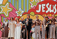 "Dallas, Texas - June 01, 1972. Johnny Cash performing at ""Explo 72"" with June Carter and her family. The Explo 1972 was an evangelical conference and festival that took place in Dallas, Texas, from June 12 to June 17. The event was sponsored by the Campus Crusade for Christ and organized by Paul Eshleman. A crowd of 80,000 mostly young people from over 75 countries congregated to praise Jesus. An even larger crowd of 180,000 came to the nine hour rock festival that closed the festivities."