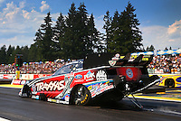 Aug. 2, 2014; Kent, WA, USA; NHRA funny car driver Courtney Force during qualifying for the Northwest Nationals at Pacific Raceways. Mandatory Credit: Mark J. Rebilas-USA TODAY Sports