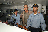 United States President George W. Bush takes a tour of the Bridge during a his visit aboard USS Abraham Lincoln (CVN 72) on May 1, 2003.  The President is conducting a visit aboard ship to meet with the Sailors and will address the Nation as Lincoln prepares to return from a 10-month deployment to the Arabian Gulf in support of Operation Iraqi Freedom. <br /> Credit: United States Navy via CNP