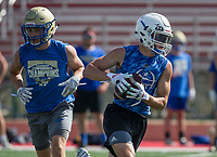 NWA Democrat-Gazette/BEN GOFF @NWABENGOFF<br /> Mason Ross of Rogers runs past Logan King, Harrison linebacker, Thursday, July 11, 2019, during the Border Battle 7-on-7 Tournament, in partnership with the Pro Football Hall of Fame Scholastic 7v7 series, at Branson (Mo.) High School's Pirates Stadium.