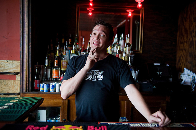 "UNITED STATES - JUNE 21:  Fritz Wood, general manager of Rock and Roll Hotel on H Street, NE, makes the sign language sign for ""red,"" as part of the sign for the drink order Red Bull and vodka.  Many bartenders and wait staff around Capitol Hill have learned basic signs to serve deaf patrons, many coming from nearby Gallaudet University.  (Photo By Tom Williams/Roll Call)"