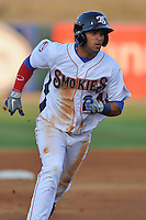 Tennessee Smokies center fielder Rubi Silva #24 runs to third during a game against the Chattanooga Lookouts  at Smokies Park on April 10, 2013 in Kodak, Tennessee. The Lookouts won 6-2. (Tony Farlow/Four Seam Images).