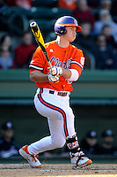 First baseman Jon McGibbon (12) of the Clemson Tigers in the Reedy River Rivalry game against the South Carolina Gamecocks on March 1, 2014, at Fluor Field at the West End in Greenville, South Carolina. South Carolina won, 10-2.  (Tom Priddy/Four Seam Images)