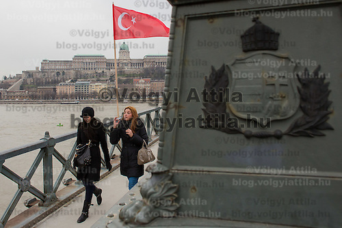 Turkish flag waves in front of the formerly Turkish controlled Castle of Buda with a Hungarian national symbol in front on the Chain Bridge to honour the visit of Recep Tayyip Erdogan Prime Minister of Turkey in Budapest, Hungary on February 05, 2013. ATTILA VOLGYI