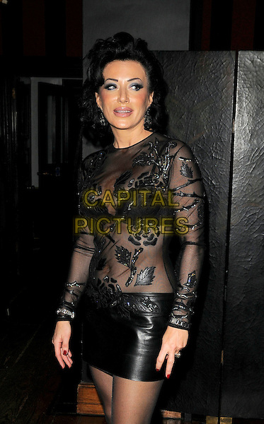 NANCY DELL'OLLIO.At Nancy Dell'Ollio's Christmas Party, Blake-s hotel, Roland Gardens, London, England..December 16th, 2008.dell olio half 3/4 length black leather skirt pvc  sheer cleavage lace see through thru .CAP/CAN.©Can Nguyen/Capital Pictures.