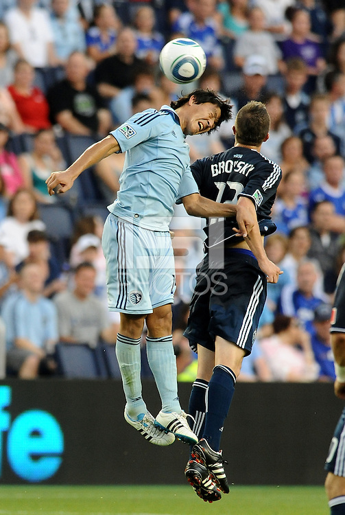 Roger Espinoza (light blue) Sporting KC goes up for a header with Jeb Brovsky Vancouver Whitecaps..... Sporting KC defeated Vancouver Whitecaps 2-1 at LIVESTRONG Sporting Park, Kansas City, Kanas.