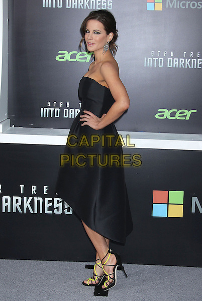 "Kate Beckinsale.""Star Trek Into Darkness"" Los Angeles Premiere held at the Dolby Theatre, Hollywood, California, USA..May 14th, 2013.full length back strapless dress black side yellow strappy sandals shoes hand on hip.CAP/ADM/RE.©Russ Elliot/AdMedia/Capital Pictures."