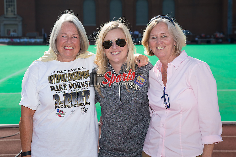 Julie Griffin (left) and Roxann Moody (right) pose with recent Wake Forest Sports Hall of Fame inductee Kelly Dostal prior to the field hockey match between the North Carolina Tar Heels and the Wake Forest Demon Deacons at Kentner Stadium on October 23, 2015 in Winston-Salem, North Carolina.  The Demon Deacons defeated the Tar Heels 3-2.  (Brian Westerholt/Sports On Film)