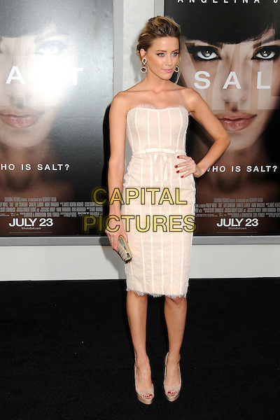 "AMBER HEARD .""Salt"" Los Angeles Premiere held at Grauman's Chinese Theatre, Hollywood, California, USA, 19th July 2010..full length hand on hip strapless dress beige cream peep toe platform shoes lace nude gold clutch bag .CAP/ADM/BP.©Byron Purvis/AdMedia/Capital Pictures."