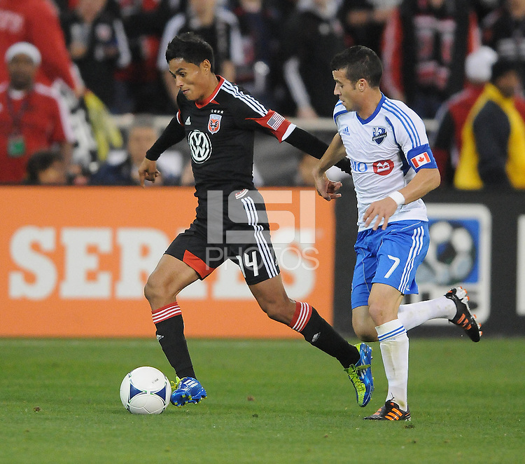 D.C. United midfielder Andy Najar (14) shields the ball against Montreal Impact midfielder Felipe Martins (7) D.C. United tied The Montreal Impact 1-1, at RFK Stadium, Wednesday April 18 , 2012.