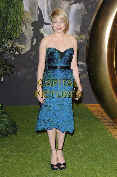 Michelle Williams.attended the 'Oz The Great & Powerful' UK film premiere, Empire cinema, Leicester Square, London, England, UK, 28th February 2013..full length strapless blue green teal feather dress black ankle strap peep toe shoes sandals clutch bag belt waistband .CAP/CAN.©Can Nguyen/Capital Pictures.