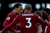 17th March 2019, Craven Cottage, London, England; EPL Premier League football, Fulham versus Liverpool; Virgil van Dijk of Liverpool joins in the celebrations as James Milner scores for 1-2 from a penalty in the 81st minute