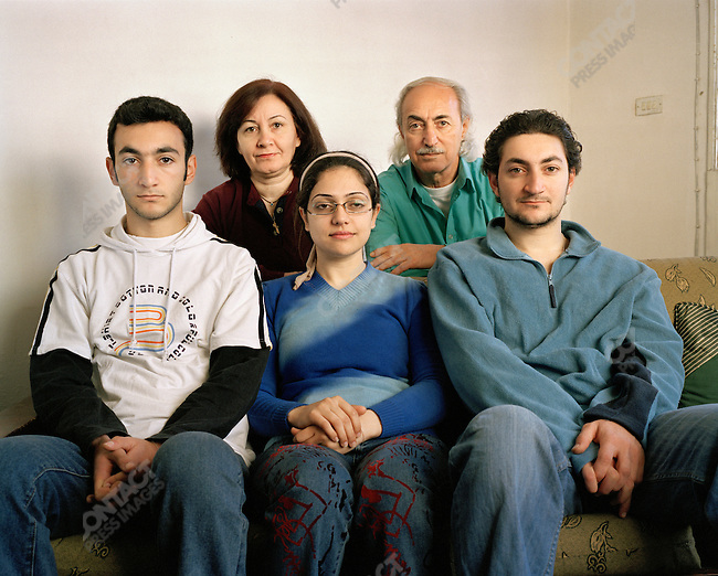 Hrayer with his wife Ophelia, their sons and a cousin (who just arrived from Iraq as a refugee after her friend was killed. She does not want to give her name or name of the foreign organization she worked for in Iraq). They are Armenian Orthodox from Basra, Iraq. The main part of this family left Iraq in 2001 after their daughter was abducted and they received death threats. They are still unable to return home. ..Al Ashrafieh area of Amman, Jordan, April, 2007..DIRECT QUOTES FROM HRAYER AVAILABLE