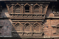 Kathmandu, Nepal.  Carved Window in the Kumari Bahal, House of the Kumari Devi, a Young Girl Revered as a Living Goddess.  The windows are carved from sal wood, shorea robusta, and were carved in the mid-eighteenth century.