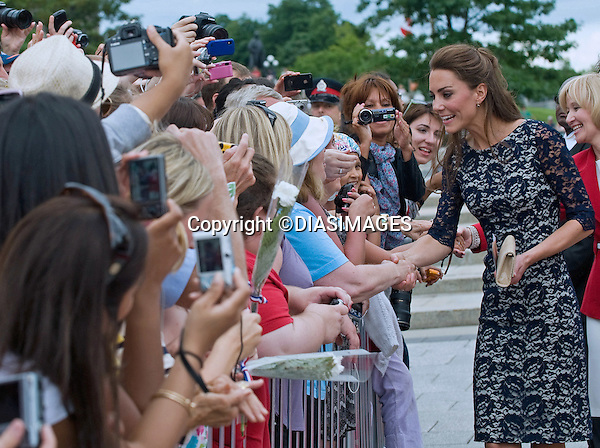 """WILLIAM & KATE VISIT THE NATIONAL WAR MEMORIAL.where they lay a wreath and a bouquet, Ottawa, Canada_30/06/2011.Mandatory Credit Photo: ©DIASIMAGES..**ALL FEES PAYABLE TO: """"NEWSPIX INTERNATIONAL""""**.No UK Usage until 27/07/2011.IMMEDIATE CONFIRMATION OF USAGE REQUIRED:.DiasImages, 31a Chinnery Hill, Bishop's Stortford, ENGLAND CM23 3PS.Tel:+441279 324672  ; Fax: +441279656877.Mobile:  07775681153.e-mail: info@newspixinternational.co.uk"""