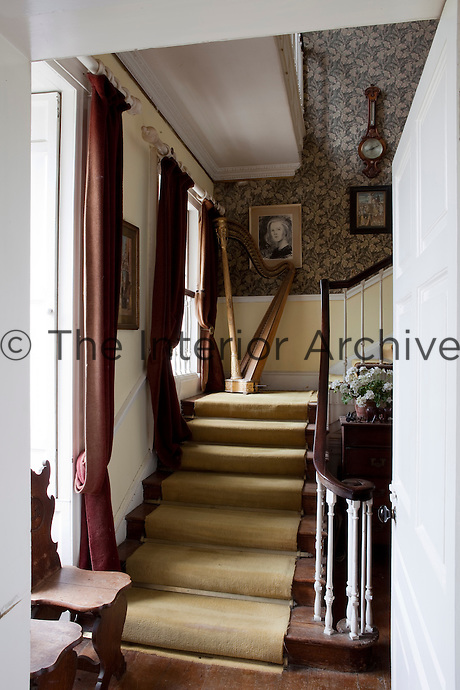 The simple wooden staircase was added in the eighteenth century