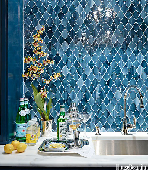 This custom home bar features Aladdin, a handmade mosaic shown in Marcasite jewel glass from New Ravenna.<br />