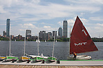 Sailboats at MIT boat dock. Charles River, Cambridge, Boston in background.
