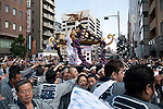 Tokyo, Japan - Thousands of people attend to see carrying portable Shinto Temples (Mikoshi) during the Sanja Matsuri in Asakusa district, May 19, 2013. The Sanja Matsuri is one of the Three Great Shinto Festivals in Tokyo and is held on the third weekend of May at Asakusa Temple. (Photo by Rodrigo Reyes Marin/AFLO)