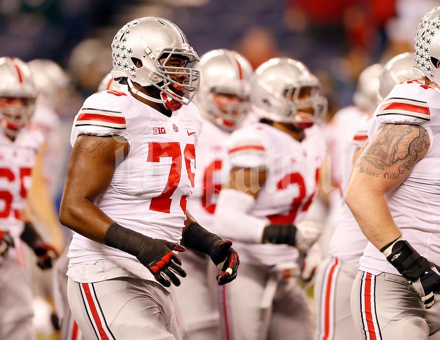 Ohio State Buckeyes offensive linesman Marcus Hall (79) warms up with the team prior to the Big Ten championship football game against the Michigan State Spartans at Lucas Oil Stadium in Indianapolis on Dec. 7, 2013. Hall lost his starting job last week after making an obscene gesture during the Michigan game. (Adam Cairns / The Columbus Dispatch)