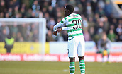 17th March 2019, Dens Park, Dundee, Scotland; Ladbrokes Premiership football, Dundee versus Celtic; Timothy Weah of Celtic points to his wrist as 6 minutes injury time is announced