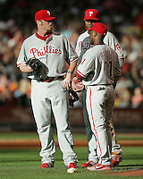 Phillies pitcher Brett Myers talks with SS Jimmy Rollins and 1B Ryan Howard on Saturday May 24th at Minute Maid Park in Houston, Texas. Photo by Andrew Woolley / Four Seam Images...