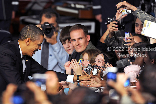 Elmendorf AFB, AK - November 12, 2009 -- United States President Barack Obama shakes hands with military personnel and civilians at Elmendorf Air Force Base, Alaska, November 12, 2009. .Mandatory Credit: Laura Turner - USAF via CNP