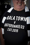 Bala Town 3 FC Differdange 4, 03/08/2015. Belle Vue, Europa League. A home fan with a commemorative t-shirt before the Europa League first qualifying round, second leg tie between Bala Town from Wales and FC Differdange 03 of Luxembourg. It was the Welsh club's second season of European competition, and due to ground regulations the match was played at nearby Belle Vue, home of Rhyl FC. The visitors won the tie 4-3 on aggregate due to a last-minute away goal by Omar Er Rafik, in a game watched by 1039 fans and progressed to play Turkish giants Trabzonspor in the next round. Photo by Colin McPherson.