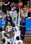 SIOUX FALLS, SD: MARCH 20:  De'Jon Davis #44 of Cal Baptist shoots over Queens defender ate Small #24 during their game at the 2018 Division II Men's Elite 8 Basketball Championship at the Sanford Pentagon in Sioux Falls, S.D. (Photo by Dick Carlson/Inertia)