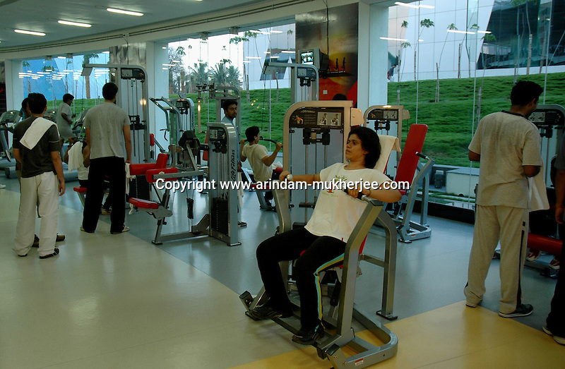 Indian software professionals working out in the gym at Infosys campus in Bangalore. Infosys is the largest software company in the country and the head office is in Bangalore, Karnataka, India. Arindam Mukherjee