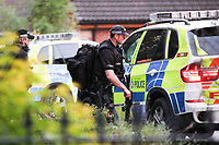 Police execute a search warrant at an address in Moorgate, Rotherham, on Thursday night supported by armed officers.<br />