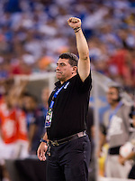 Honduran head coach Luis Fernando Suarez waits for the final whistle during the quarterfinals of the CONCACAF Gold Cup at M&T Bank Stadium in Baltimore, MD.  Honduras defeated Costa Rica, 1-0.