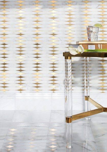 Hudson, a stone waterjet mosaic, shown in Venetian honed Calacatta Gold and Brass, is part of the Trove® collection for New Ravenna.