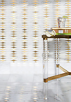 Hudson, a stone waterjet mosaic, shown in Venetian honed Calacatta Gold and Brass, is part of the Trove Collection for New Ravenna.
